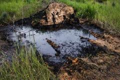 Contaminación por petróleo industrial Foto de archivo libre de regalías