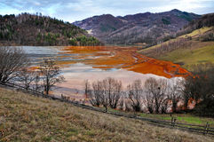 Contaminated lake full with mining residuals in Rosia Mont Royalty Free Stock Photo