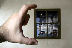 Contamination. A hand framing a window, with a scene of environment polluted by heavy industrial activity Royalty Free Stock Photo