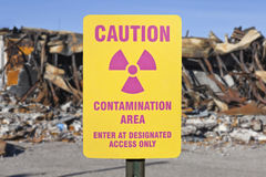 Contamination Area Warning Sign with Ruin. Background royalty free stock image