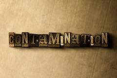 CONTAMINATION - close-up of grungy vintage typeset word on metal backdrop. Royalty free stock illustration.  Can be used for online banner ads and direct mail Stock Photography