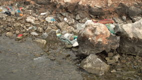 Contamination of the sea. Piles of garbage waste environmental disaster on a sea shore. Contamination of the sea. Piles of garbage waste environmental disaster stock video footage