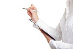 Contando con la penna ed i appunti Fotografie Stock
