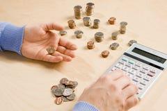 Contando moedas Fotografia de Stock