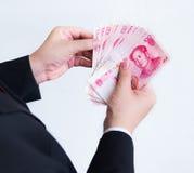 Contando Yuan ou RMB, moeda chinesa Foto de Stock Royalty Free