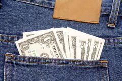 Contant geld in de zak van denimjeans Royalty-vrije Stock Afbeelding