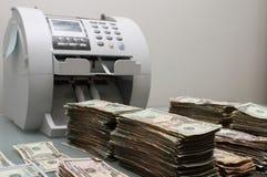 Contant geld en teller Royalty-vrije Stock Foto