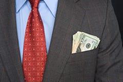 Contant geld in kostuumzak Stock Foto's