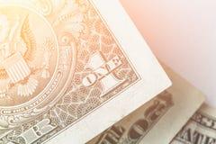 Contanti, soldi, foto del primo piano, un effetto del filtro dalla banconota della banconota in dollari al sole Immagini Stock Libere da Diritti