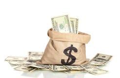 contas de dólar em um saco Fotos de Stock