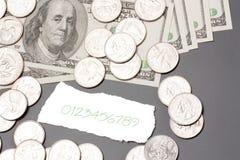 Contas de dólar, moedas Fotos de Stock