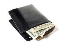 Contas de dólar na carteira de couro preta Imagens de Stock
