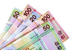 Contas de moeda do dólar do dinheiro de Hong Kong isoladas no branco Fotografia de Stock