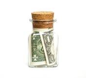 contas de Um-dólar em um frasco de vidro, em um fundo branco Imagens de Stock Royalty Free