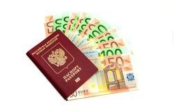 Contas do Euro no passaporte no branco Foto de Stock Royalty Free