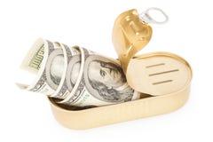 Contas dos dólares americanos na lata do metal Fotografia de Stock Royalty Free