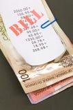 Contas e dólares canadianos Imagem de Stock