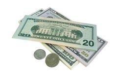 Contas e moedas dos E.U. Fotografia de Stock