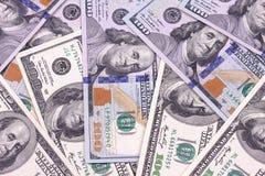 Contas novas e velhas de cem fundos abstratos do dólar Fotografia de Stock Royalty Free