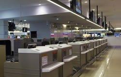 Contatori di registrazione nell'aeroporto di Melbourne Fotografia Stock