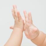 Contatto isolato della mano del bambino Fotografia Stock Libera da Diritti