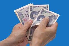 Conteggio dei soldi Fotografia Stock