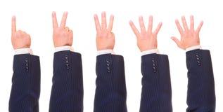 Conteggio delle mani dell'uomo Fotografia Stock