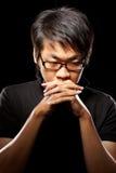 Contemplate Asian man Stock Photo