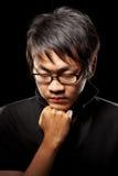 Contemplate Asian man Stock Images
