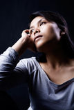 Contemplate woman in dark Royalty Free Stock Photography