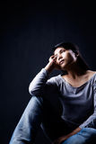 Contemplate woman in dark Stock Photos