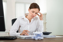 Contemplated Businesswoman Calculating Receipts Stock Images