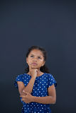 Contemplated girl with hand on chin Stock Image