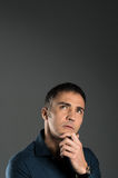 Contemplated Mature Man. Portrait Of Pensive Mature Man With Hand On Chin On Grey Background royalty free stock images
