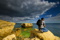Contemplating. A man contemplating the beautiful rock formations Stock Images
