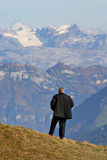Contemplating. Man contemplating the scenery in the Swiss Alps stock images