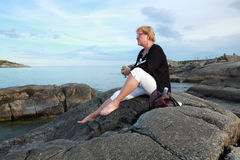 Contemplating adult woman at sea side Royalty Free Stock Photos