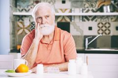 Contemplating aged man stock photography