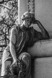 Contemplating Angel at Cemetery. Contemplating Angel sculpture at a Cemetery royalty free stock photo