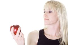 Contemplating an apple Royalty Free Stock Photo