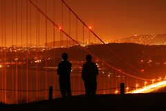 People watching over San Francisco. The silhouettes of people watching over San Francisco and the Golden Gate bridge at night Stock Photography