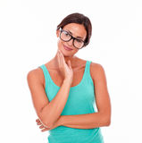 Contemplating brunette woman with green tank top Stock Images