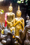 Contemplating Buddha in thailand. The Friday Buddha image is standing with both arms crossed over the chest with the right hand covering the left Royalty Free Stock Image