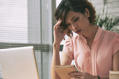 Contemplating business lady Stock Photography