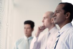 Contemplating business people Stock Photo
