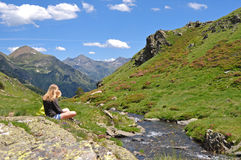 Contemplating the creek. Two girls contemplating a stream  in the Pyrenees Mountains of Andorra. We hiked in this beautiful little country during our trip around Stock Images
