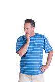 Contemplating dissapointed  man. Middle aged white man in a blue striped shirt thinking or contemplating Stock Photography