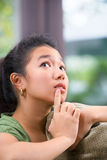 Contemplating female teenager Stock Images