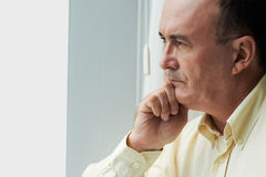 Contemplating man Stock Images