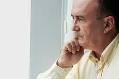 Contemplating man stock images